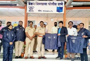 Data Care Corporation distributes raincoats to police at Deccan Police Station