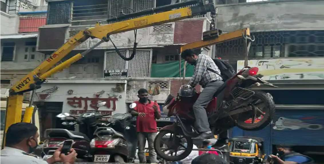 two wheeler driver also loaded in towing van along with vehicle action of pune traffic police
